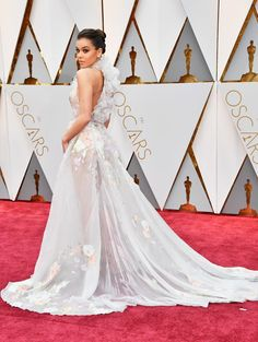 6d0addf5478acb Hailee Steinfeld wore a  RalphandRusso Spring 2017 Couture floral halter  gown to the 2017 Academy