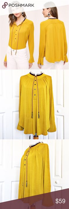 """Anthropologie Goldie Blouse by Akemi + Kin Beautiful yellow mustard Blouse by Akemi + Kin for Anthropologie.  Features a half button up style with knit detail at the neckline and beaded tassels.  Material tag has been listed.  Measurements laid flat: bust 22"""" and length from top of shoulder to hem 28"""". Measurements are approximate. Anthropologie Tops Blouses"""