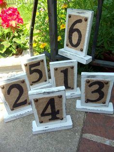 What a great idea for rustic wedding decor.  These table numbers are distressed and have burlap attached.  They would look so beautiful on reception wedding tables or at parties with assigned guest seating.  They look rustic and can be made to order.  I love the burlap and distressed look for weddings.