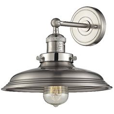 The Elk Lighting Newberry Wall Sconce presents a vintage character with high quality detailing and timeless appeal. The solid cast socket holder is stamped, true to the vintage aesthetic and sentimental charm. The spun metal shade has the classic shape, bring a nostalgic air with a vintage reproduction bulb.