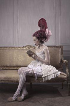 Model reading in 18th century undergarments. Corsets, panniers, panties and stockings: Clara Maeda. Mouches: Mily Serebrenik. Feathers: Temps d'Elégance. Shoes: Ernest. Corset is made of silk taffeta and burned out velvet, cotton lace applique...