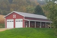 Lester Buildings Pole Barn/Post Frame Home. Residential. Two-story living area, large covered porch with Y-brace porch posts, bale door, Hayfield windows, Clopay overhead doors. #polebarn #postframe #home #design #exterior #barn #farmhouse