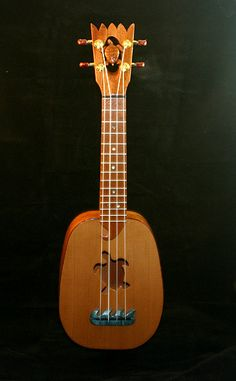 .i need this ukulele...it's so much prettier than mine.