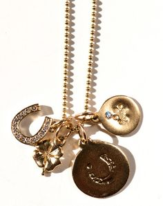 Helen Ficalora charms: These casual charms are a perfect gift for a woman with a natural, no-fuss style. Choose charms like a paw print or yoga pose based on her interests, or go for an of-the-moment initial necklace.