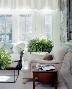 Although all white wouldn't be a good idea in our sun room (dogs, cats, naps, etc) I love this look.