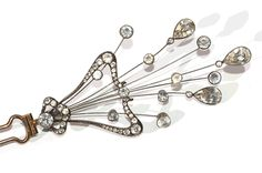 Charming early 19th century aigrette hair ornament of bright foiled white paste, set silver. The aigrette is articulated and 'en tremblant', with paste drops on fine silver wires which move when worn in the hair. The comb pins are gold. The aigrette is 18.5 cm
