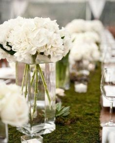 Achieve this stunning look at your wedding or dinner party with vases of fresh (or dried or sola!) flowers sitting on a Moss Table Runner down the center of the table.  Order now for your summer events! Photo from @stylemepretty - we love this tablescape!⁣ #moss #mosstablerunner #tablerunner #tablesetting #tablescape #dinnerparty #weddingdinner #weddinginspiration #partyplanner #eventplanner #tabledesign #weddingreception ⁣ #weddingideas #weddingflowers #weddingstyle
