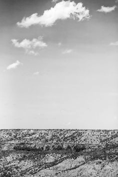 Black and white photograph of the big sky over the rugged landscape of Palo Duro Canyon, in the Texas Panhandle. Standard Prints: - Printed on real silver-based Resin Coated (RC) photo paper - Include