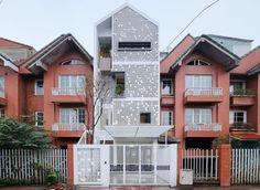 Cocoon Hous, Vietnam, green renovation, row house, perforated brick facade,perforated facade, brickwork, natural ventilation, vertical garden, Landmak Architecture
