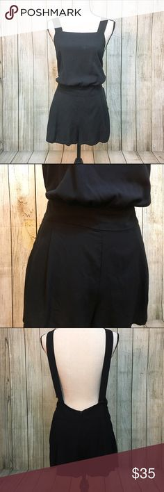Black Romper NWT. Black overall style romper w/ 2 side pockets and pleated shorts  LENGTH: 25in 97% Polyester 3% Spandex  DISCLAIMER - Reasonable offers accepted on items not marked 'price firm' - 15% off on bundles of 2 or more items - I do not discuss prices in the comments, but feel free to ask any other questions Urban Outfitters Dresses Mini