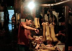 A butcher cleans cow's feet at his stall in a market in Jakarta, Indonesia, July 26, 2012. (Dita Alangkara/Associated Press) #
