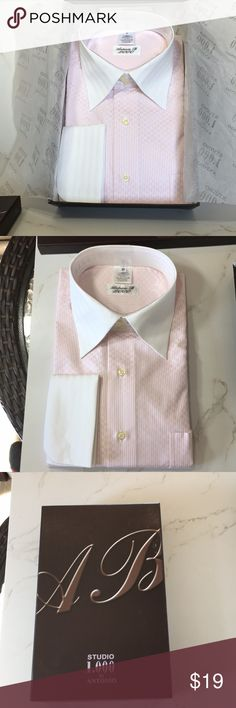 Long sleeve men dress shirt NWT Antonio B 2000 long sleeve men dress shirt with cufflinks. It has a salon pink color with a white collar. Come with a box and has that new smell shirt. Size 16 1/2. Antonio B Shirts Dress Shirts
