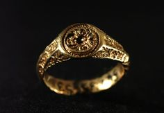 15th century gold signet ring engraved with a leopard's head holding a ring. It is meant for love tokens rather than business!