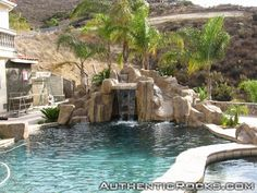 Artificial rock slide with waterfall for swimming pool.
