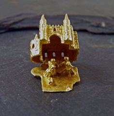 A Lovely Vintage 9ct Gold Charm of Cinderella's Castle  It opens open to reveal Cinderella , the Prince and her slipper  Hallmarked for 9ct Gold, London 1959  Nicely detailed and cast  It measures 1.5cm x 1cm x 1cm & weighs 5.4 grams