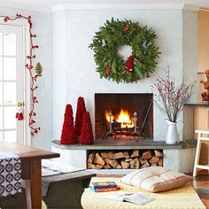 Don't have a mantel? Dress up a bare wall or facade with an oversized wreath. Looks pretty cozy to me!