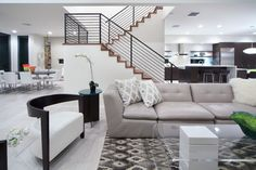 PKDG Spring 2014 Parade of Homes Entry - Modern living room, stairs, kitchen and dining