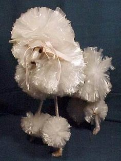 LONG ago (1960's poodles from wire hangers &  plastic pom-poms. They looked something like this