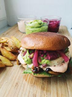 Vegetarian burger with halloumi, guacamole, bbq-marinated mushrooms and chili mayo