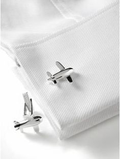 Airplane cuff links from Banana Republic. They were a Christmas gift for Isaiah. He really likes them, because they're airplanes. And he loves to fly airplanes. #aviationweddingdress
