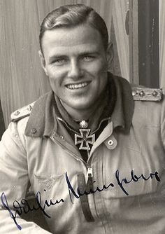 Major Joachim Müncheberg (1918 – 1943), Luftwaffe fighter ace credited with shooting down 135 enemy aircraft including 46 Supermarine Spitfire fighters. He succumbed to battle wounds, on 23 March 1943. Iron Cross, 2nd Class, 1st Class, German Cross in Gold, Knight's Cross of the Iron Cross with Oak Leaves and Swords.