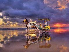 """Leaving after sunset"" Parangtritis Beach | Yogyakarta - Indonesia    By: Alex Hanoko"