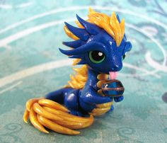 Again looking at the colour combinations - Blue and Gold Curious Dragon by DragonsAndBeasties on Etsy