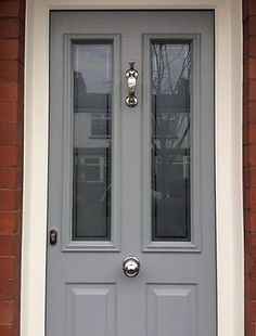 Grey front door with silver details