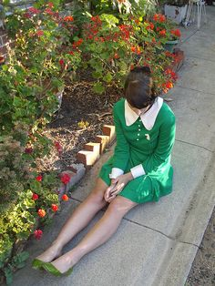 Love this green elfin dress with a different shade of green shoes.