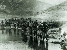 'Unimaginable bravery': How 700 Canadian soldiers defeated 5,000 enemy troops in the forgotten battle of Kapyong - Members of the Princess Patricia's Canadian Light Infantry wade a river in the Kapyong Valley near Seoul, Korea. The Canadians stopped an invading force that outnumbered them seven to one.