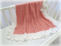 Charming little blanket with a lightly ruffled border will be a welcome gift for a newborn baby.  The pattern instructions are simple and easy with many step by step pictur... #crochet #knit