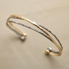 """END TO END CUFF--One 14kt gold filled band makes its way from end to end, crossing paths with oxidized sterling silver. Our exclusive cuff bracelet is hammered for texture, flexible for comfort. Handmade in USA. 2-1/2"""" dia."""
