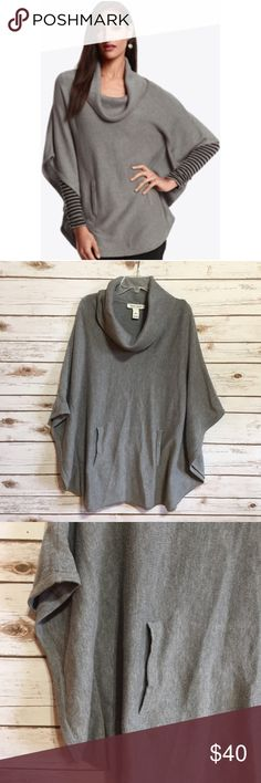 💗WHBM gray batwing poncho sweater Size XS. White House Black Market. Grey batwing poncho sweater.  Cotton blend poncho features a modern cowl neck, batwing sleeves and vertical pockets. Cotton, polyester. Relaxed fit. Circular design. Hits below the hip on most body types. EUC  💟Fast 1-2 day shipping 💟Reasonable offers accepted 💟Purchase 3 or more items & get a special bundle rate!  💟Smoke-free home White House Black Market Sweaters Shrugs & Ponchos
