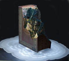 Guy laramée-DRAGON-dessus des nuages. 2014.  Webster Dictionary, encres,  pigments, plexiglas, bois, LEDs.  18 x 21 x 16 (h) pouces.  (47,7 x 53,3 x 40,6 cm)