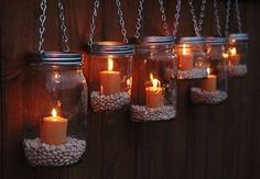 Easy-to-Make garden luminaries. Add some dried beans to the bottom of a mason jar and string them up. Great idea for patio lighting.