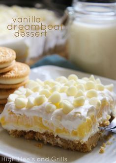 Vanilla Dreamboat Dessert...made with a golden Oreo buttery crumb crust, cream cheese, cool whip, vanilla pudding, and topped off with white chocolate chips.  So decadent and delicious!!   www.highheelsandgrills.com/2013/06/vanilla-dreamboat-dessert.html