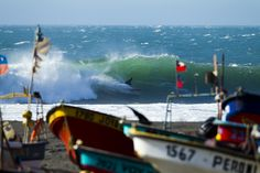 Surfer Magazine editorial trip to South America October 2011. Boats in front and land? Cool looking ocean too.