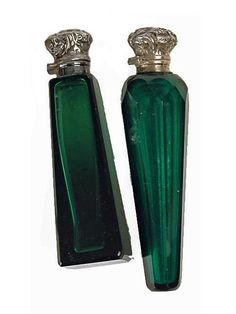 Two Edwardian green glass silver topped perfume bottles, one marked Birmingham 1907 on top, one of slender tapering form with facet cut decoration, the other of square Eiffel Tower form.