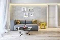 Jasna podłoga i odcienie szarości królują w nowoczesnych wnętrzach! Akcent kolorystyczny dodaje całości nowej energii i świeżości. :)  W http://eurostandard.pl/ pomożemy Ci osiągnąć podobny efekt!  Foto: http://www.homebook.pl/inspiracje/salon/223756_-salon-styl-skandynawski