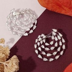A study in simplicity! A @niravmodijewels Melody Hoop Earrings featuring pear-shaped diamonds. Simply divine! #diamonds #luxury #jewelry #finejewelry
