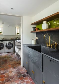 In a colorful Brooklyn brownstone, three rolling carts—for darks, lights, and colors—tuck conveniently under the counter. See The Architect Is In: A Brooklyn Brownstone Transformed, with Respect. Brooklyn Brownstone, Black Kitchens, Home Kitchens, Kitchen Black, Charcoal Kitchen, Küchen Design, House Design, Interior Design, Design Elements