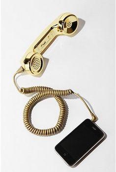 Metallic golden retro phone handset.