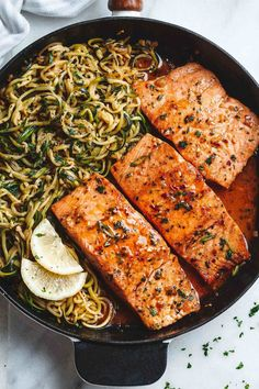 Lemon Garlic Butter Salmon with Zucchini Noodles - Light, low carbs and ready in 20 minutes. Dinner perfection for any weeknight! dinner salmon Lemon Garlic Butter Salmon with Zucchini Noodles Fish Recipes, Seafood Recipes, Keto Recipes, Dinner Recipes, Cooking Recipes, Healthy Recipes, Weeknight Recipes, Noodle Recipes, Salmon Low Carb Recipes