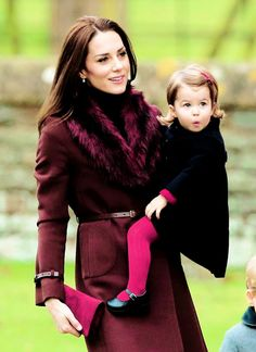 The Cambridges. I love the look on Princess Charlotte's face.  What a charming little girl.