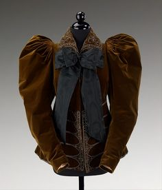 """""""Every element of this Worth jacket is of the highest quality, as expected of the preeminent house in the 1890s. Worth studied and often reinterpreted historical fashions as can be seen here in the back configuration, collar and overall decorations which evoke 17th-century menswear."""" #Victorian #fashion #brown #jacket #1800s"""