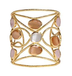 Crafted from intricate brass wiring studded with rose quartz as well as white and peach moonstones, this cuff bracelet will bewitch you with its complex design. Intertwining metal and natural stones evoke the intricate rhythms of nature and its enduring mysteries in this stunning piece. Mesmerize friends and family by including our Sorcery Cuff in your collection.