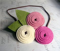 have to buy, but they look easy enought to make.  Felt flowers small circle on top of largers circles, sew x in the middle.
