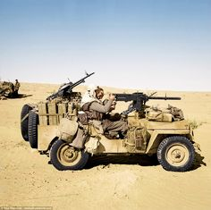 An SAS jeep in the Gabes-Tozeur area of Tunisia. The vehicle is heavily loaded with jerricans of fuel and water, and personal kit. The 'gunner' is manning the inch Browning heavy machine gun, while the driver has a single Vickers 'K' gun in front, and Military Jeep, Military Vehicles, Military Art, Afrika Corps, North African Campaign, Special Air Service, Old Jeep, Jeep 4x4, Willys Mb