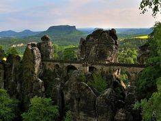 Located in the sandstone mountains of Saxon Switzerland Elbe in Germany. The Bastei is a rock formation that towers 194 metres above the Elbe River. The jagged rocks were formed by water erosion over one million years ago Places To Travel, Places To See, Travel Destinations, Kids Places, Europe Places, Places Around The World, Around The Worlds, Old Bridges, Destination Voyage