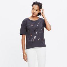In an easy boyish shape with split side vents, this supersoft T-shirt is printed with a colorful abstract design. <ul><li>True to size.</li><li>Cotton.</li><li>Machine wash.</li><li>Import.</li></ul>